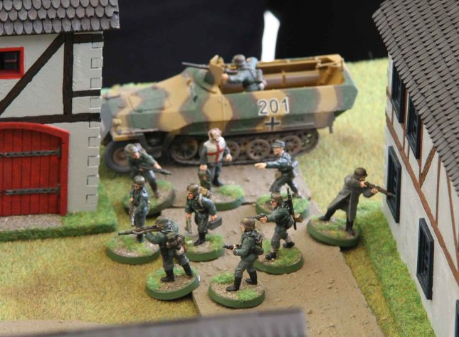 Panzergrenadier reenforcements debussing in the village square