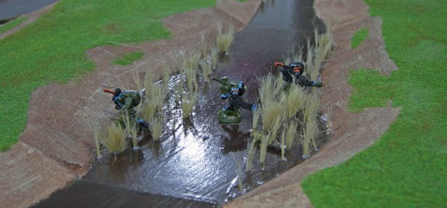 Tau Stealth suits on the swamp board