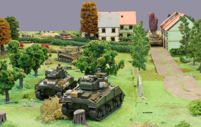 Shermans advancing on the village