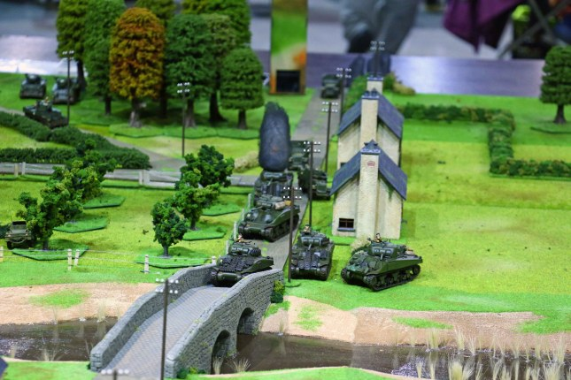 Crisis 2014 - British Shermans driving up to the bridge passing the burning Firefly