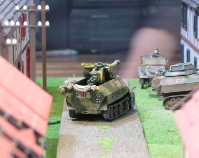 German halftracks staging inside the village